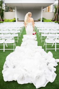 Bride walking down the aisle on the Celeste Event lawn